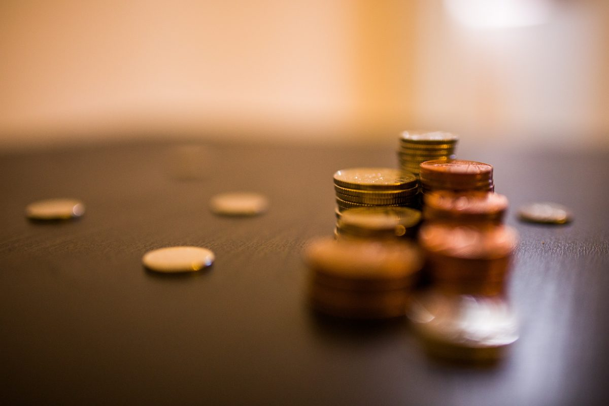 A small collection of copper coins in a neat stack upon a table