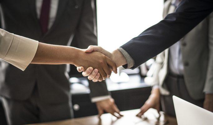 Handshake between formally dressed individuals